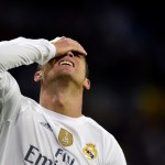 """TOPSHOTS Real Madrid's Portuguese forward Cristiano Ronaldo gestures during the Spanish league """"Clasico"""" football match Real Madrid CF vs FC Barcelona at the Santiago Bernabeu stadium in Madrid on November 21, 2015. AFP PHOTO/ JAVIER SORIANO / AFP / JAVIER SORIANO"""