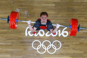 Indonesia's Eko Yuli Irawan competes during the Men's 62kg weightlifting competition at the Rio 2016 Olympic Games in Rio de Janeiro on August 8, 2016.  / AFP PHOTO / POOL / Stoyan Nenov