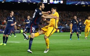 Luis Suarez of FC Barcelona appears to kick out at Juanfran of Atletico Madrid after a challenge during the UEFA Champions League Quarter Final First Leg match between FC Barcelona and Atletico Madrid played at The Camp Nou, Barcelona on April 5th 2016